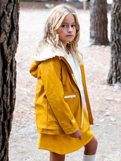 Hooded raincoat with faux fur lining