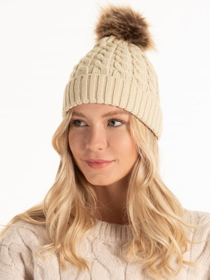 Knitted beanie with faux fur pom